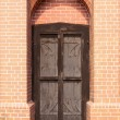 Wood door, and brick wall — Stock Photo