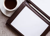 Blank white notebook, pen and cup of coffee — Stock Photo