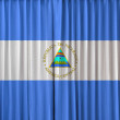 Nicaraguflag on curtain — Stock Photo #32868277