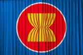 Asean wirtschaftsgemeinschaft flagge am vorhang — Stockfoto