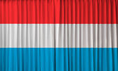 Luxembourg flag on curtain — Stock Photo