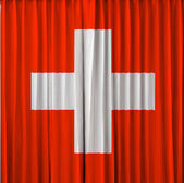 Switzerland flag on curtain — Stock Photo