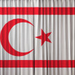 The Turkish Republic of Northern Cyprus flag on curtain — Stock Photo