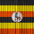 Uganda flag on curtain — Stock Photo