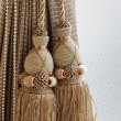 Luxury curtain and tassel — Stock Photo