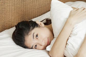 Closeup Asian woman wakeup in morning — Stock Photo
