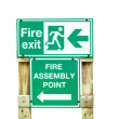 Fire exit wood sign — Stock Photo