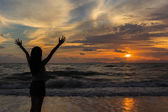 Woman silhouette in the sunset — Stock Photo
