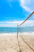Beach volleyball net on the beach with blue sky — Stock Photo