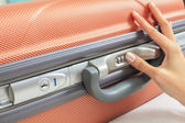 Open suitcase with security code — Stock Photo