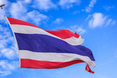 Defective waving flag of Thailand and blue sky background — Stock Photo