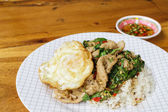 Thailand traditional food, spicy basil fried rice with pork and  — Photo