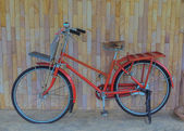 Vintage old bicycle on wall — Photo
