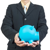 Businessman hand holding piggy bank on white background — Stock Photo