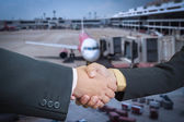 Businessman handshake with air plane transportation logistic bac — Stock Photo