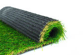 Artificial turf green grass roll on white background — Stock Photo