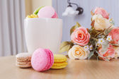 Traditional french colorful sweet Macaron in cup — Stock Photo