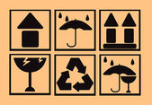 Frágil símbolo sobre fondo de cartón — Foto de Stock