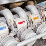 Several gasoline pump nozzles for transportation — Stock Photo #6661627