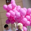 WARSAW, POLAND, September 8: Balloons and woman on XV Pink Ribbon Walk against the Breast Cancer september 8, 2012 in Warsaw, Poland. — Stock Photo #12745575