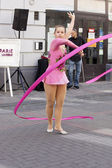 WARSAW, POLAND, September 8: Rhythmic gymnastics show on the 15th Pink Ribbon Walk against the Breast Cancer september 8, 2012 in Warsaw, Poland. — Stock Photo