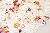 Bath salt with rose petals — Stock Photo