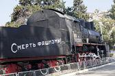 "SEVASTOPOL, UKRAINE - OCTOBER 27 , 2012: Locomotive with inscription ""Smiert Fashysmu""- ""No Fascism"", railway station,  Crimea, Ukraine on 27 October 2012 — Stock Photo"
