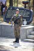 Jerzyska, Poland, Sept 18: Unidentified soldiers at the outdoor anniversary mass- place where AK soldiers was  shooten, september 18, 2013 in Jerzyska, Poland. — Stock Photo
