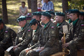 Jerzyska, Poland, Sept 18: Unidentified soldiers playing at the outdoor anniversary mass- place where AK soldiers was  shooten, september 18, 2013 in Jerzyska, Poland. — Stock Photo