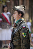 Jerzyska, Poland, Sept 18: Unidentified soldier at the outdoor anniversary mass- place where AK soldiers was shooten, september 18, 2013 in Jerzyska, Poland. — Stock Photo
