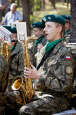 Jerzyska, Poland, Sept 18: Unidentified soldier playing at the outdoor anniversary mass- place where AK soldiers was shooten, september 18, 2013 in Jerzyska, Poland. — Stock Photo