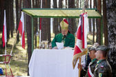Jerzyska, Poland, Sept 18: Bishop Antoni Dydycz celebrate Mass at the outdoor anniversary mass- place where AK soldiers was shooten, september 18, 2013 in Jerzyska, Poland. — Stock Photo