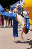 WARSAW, POLAND, june 8: Unidentified capoeira sportsmen on the XII Brazilian Festival on June 8, 2014 in Warsaw, Poland. — Stock Photo