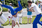 WARSAW, POLAND, june 8: Unidentified capoeira sportsmen on the XII Brazilian Festival on June 8, 2014 in Warsaw, Poland. — Photo