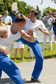 WARSAW, POLAND, june 8: Unidentified capoeira sportsmen on the XII Brazilian Festival on June 8, 2014 in Warsaw, Poland. — Стоковое фото