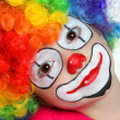 Stock Photo: Pretty girl with face painting of clown