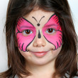 Pretty girl with face painting of a butterfly — Stock Photo #18239519