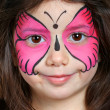 Pretty girl with face painting of butterfly — Stock Photo #18239555