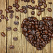Coffee heart on old wooden background — Stock Photo
