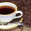 Cup of coffee with coffee beans — Stock Photo #18239597