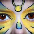 Picture of eyes from a young girl with face painting — Stock Photo