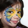 Pretty girl with face painting of a butterfly — Stock Photo #18239699