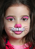 Pretty girl with face painting of a cat — Stock Photo