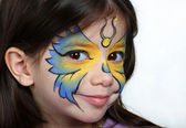 Pretty girl with face painting of a butterfly — Stock Photo