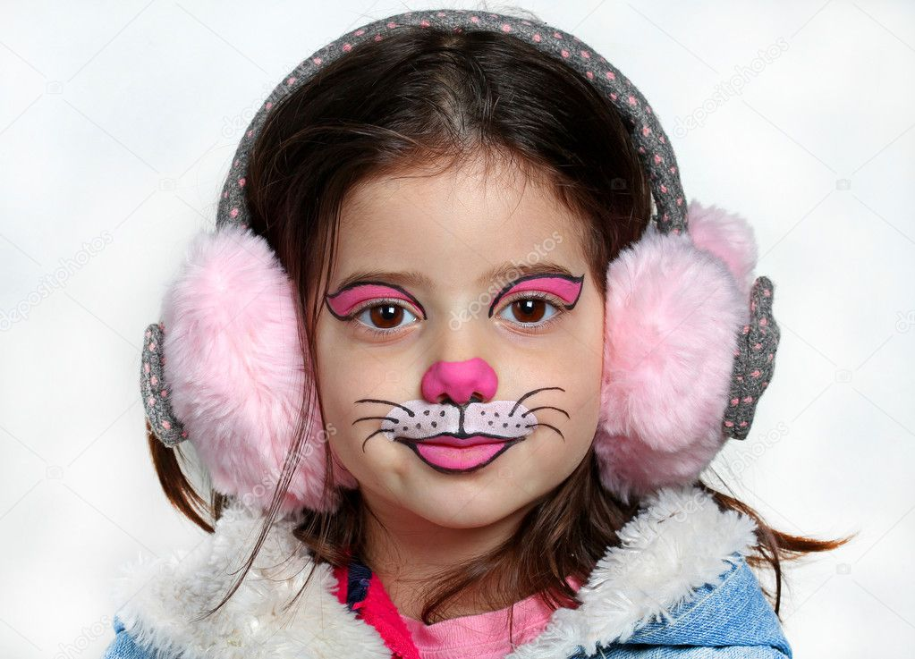 Pretty Girl With Face Painting Of A Cat Stock Photo