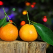 Royalty-Free Stock Photo: Clementines against christmas tree background