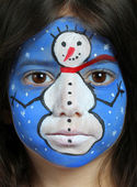 Pretty girl with face painting of a snowman — Stock Photo