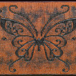 Butterfly ornament on leather belt. — Stock Photo #21147595