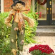 Scarecrow in front of house — Stock Photo