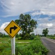 Road sign symbol and sky — Stock Photo